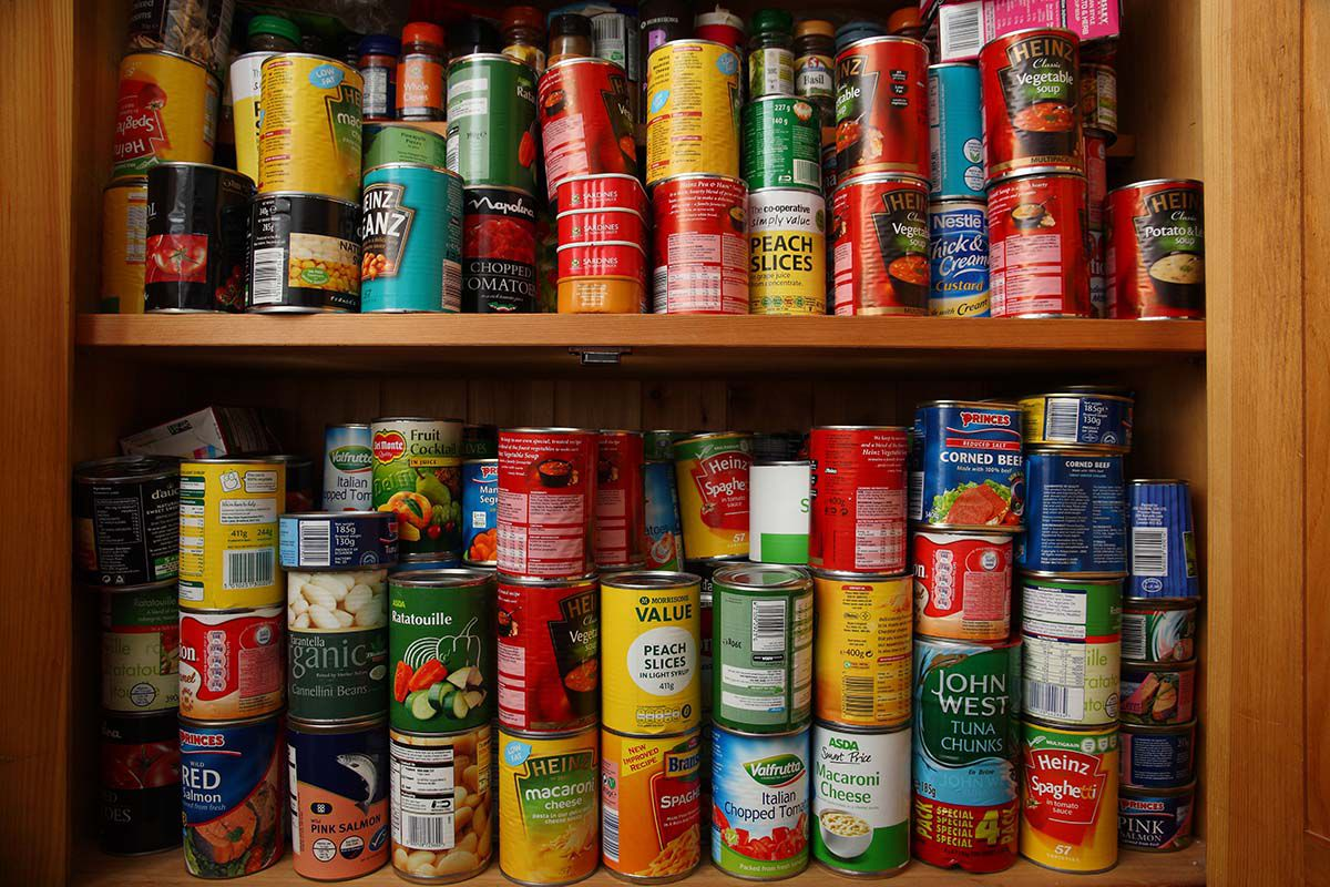 Cans of soup and other items in a cupboard