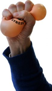 A person squeezing the absolute snot out of a 1990's stress ball