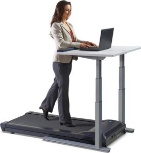 Woman pretending for one second that a treadmill desk is a good idea