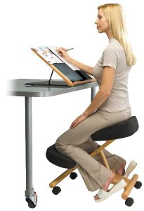 A woman seated in a kneeling ergonomic chair